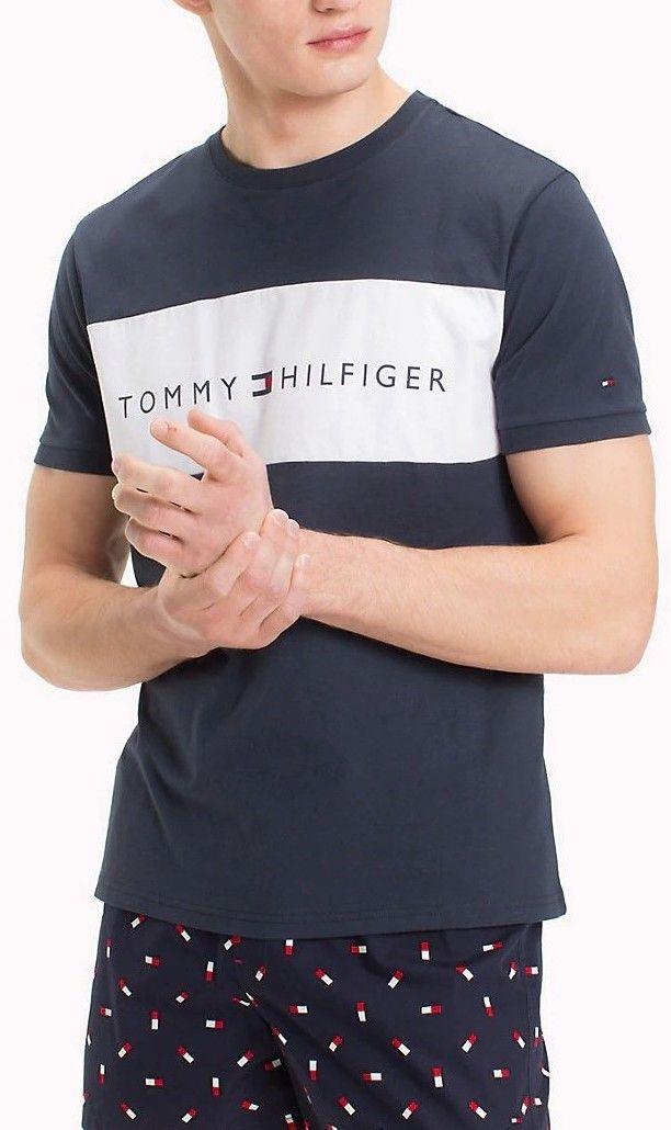 Tommy Hilfiger tmavo modré pánske tričko s bielym logom značky Tommy  Hilfiger - Lovely.sk 767ce66b4e
